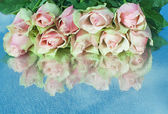 Pink roses on a mirror — Stock Photo