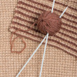 Stock Photo: Knitting pattern and wool ball