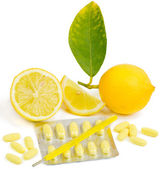 Medical thermometer, pills and lemon.  — Stock Photo