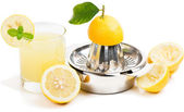 lemon juice, squeezer and fruits — Stock Photo