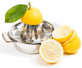Cut lemons and juicer — Stock Photo