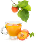 apricot juice and apricots with leaves — Stock Photo