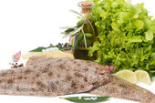 Raw common sole with  spices, lemon and olive oil  — Stock Photo