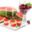 Kebab fruit on stick   with melon, cherry and water melon — Stock Photo #49203591