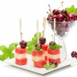 Fresh fruit kebabs on plate — Stock Photo #49203871