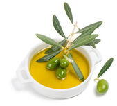 Small bowl with olive oil, decorated with a small twig with gree — Stock Photo