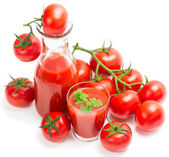 Tomato juice with branch of red tomatoes — Stock Photo
