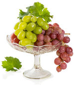 Fresh rose and green grapes with leaf — Stock Photo