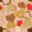 Seamless pattern of heart shape cookies — Stock Vector