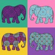 Four isolated patterned elephant — Stock Vector