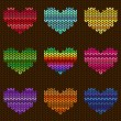 Seamless knitted pattern with hearts — Stok Vektör