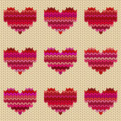 Seamless knitted pattern with hearts — Stock Vector