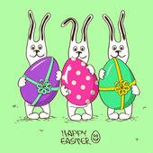 Three bunny rabbits holding Easter eggs — Stock Vector