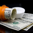 Prescription pill bottle with money — Stock Photo #17850379