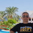 Tourism, travel. A man is photographed. Egypt, Sharm-el-Sheikh. Hotel Royal Grand Sharm — Stock Photo #34488019