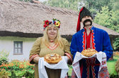 Ukrainians - a man and a woman, greeted guests with bread and salt — Stock Photo