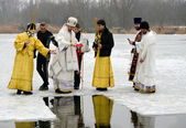Religious Christian feast of the Epiphany. Priest, the bishop blesses the water and people — Stockfoto