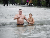 People bathe in the river in winter . Christian religious festival Epiphany — Stock Photo