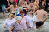 Christian religious festival Epiphany. People bathe in the river in winter . — 图库照片