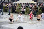 Christian religious festival Epiphany. People bathe in the river in winter . — Stock Photo