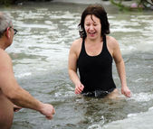 People bathe in the river in winter. Religious holiday of Epiphany — Stock Photo