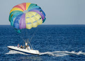 Rest on the Red Sea. People on the boat uncovered colorful multicolored parachute. — Stock Photo