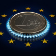 Coin one EURO and an European Union flag. — Stock Photo