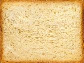 Cut of a wheaten long loaf. — Stock Photo