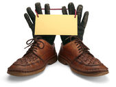 Old leather shoes and gloves. — Stock Photo