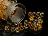 Pills with cod-liver oil — Stock Photo