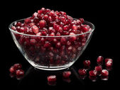 Vase with pomegranate grains — Stock Photo