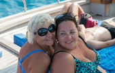 Women on the deck of the yacht. — Stock Photo