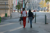 Young couple is walking near parliament in Budapest, Hungary. — Stock Photo