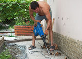 Man with electric jackhammer. — Stock Photo