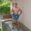Foto Stock: Athletic mposing with jackhammer at ready.