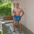图库照片: Athletic mposing with jackhammer at ready.