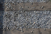 The macadam and railway ties as background. — Stock Photo
