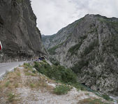 Canyon of Moraca river with mountain road and tunnel, Montenegro — Stock Photo