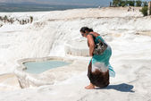 Mid adult woman on background of travertine pools in Pamukkale, — Stock Photo