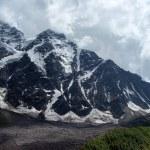 Постер, плакат: Caucasus Peaks in clouds