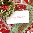 Stock Photo: Card with Christmas decoration on red background