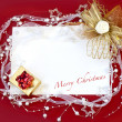 Stock Photo: Christmas card with decoration on red background