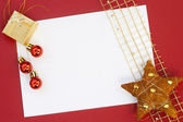 Christmas card with decoration on red background — Stock Photo