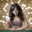 Young girl in casino on background bokeh — Stock Photo #35133421