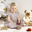 Kid with toys and decorations — Stok fotoğraf