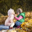 Kids kissing in forest — Stock Photo