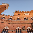 Torre Del Mangia on Pizza Del Duomo, Siena, Tuscany, Italy - Stock Photo
