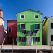 Colorful houses in Burano island, Venice, Italy - Stock Photo