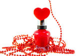 Red Nail polish, heart, beads — Stock Photo