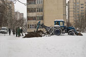 Agrimotor digging a pit in winter — Stock Photo